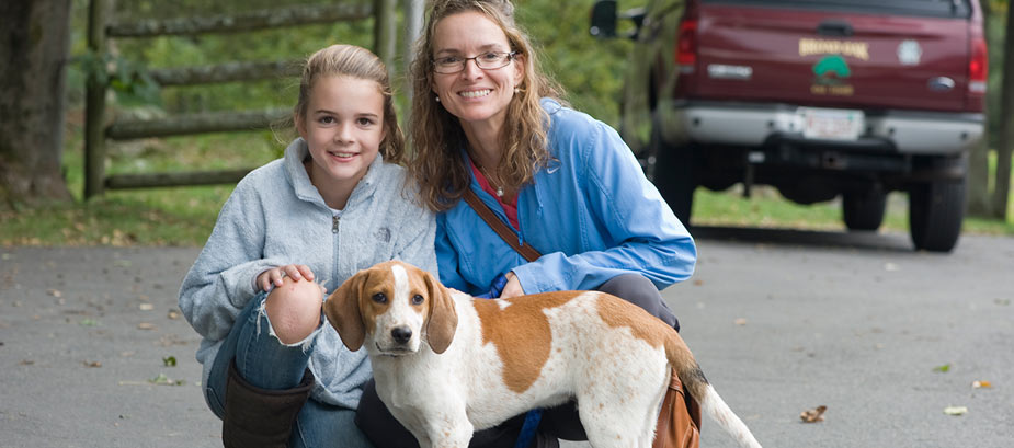Mom and girl with dog